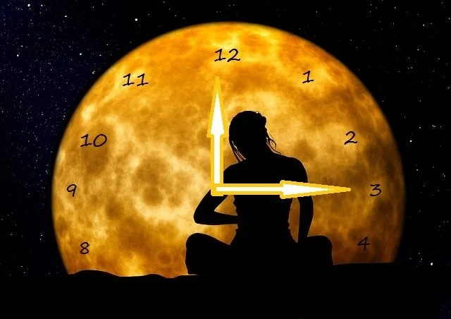 The badly adapted image is credited to neuroscience news and shows a woman meditating under a clock moon...the clock, we adapted.
