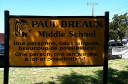 This is a bilingual school sign.