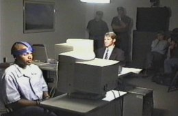 The image shows Dr. Lawrence Farwell conducts a Brain Fingerprinting test on Terry Harrington.