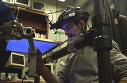 The image shows a volunteer participating in the experiment.
