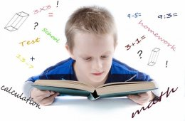 The image shows a child reading a book. Surrounding him are numbers and words associated with math.