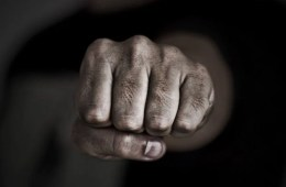 The image shows a man's fist.