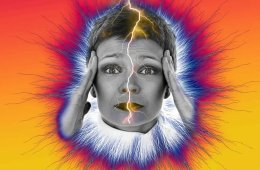 This image shows a woman holding her head in pain. There is a bolt of lightening running down her face.