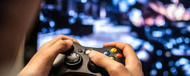 This image shows a person holding a video game controller.