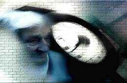 The image shows an old lady's face and clock superimposed onto a wall. The face and clock are slightly blurred.