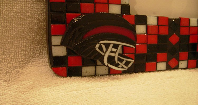 This image shows a mosaic of a Hillcrest Rams high school football helmet.