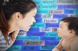The image shows a woman and a baby. The background is made up of post it notes with different words written on them.