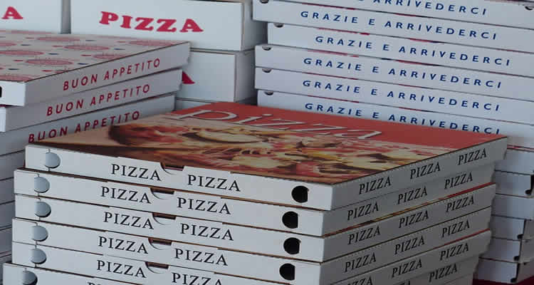This image shows pizza boxes stacked.