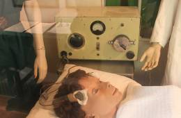 This image shows an electroconvulsive therapy machine on display at Glenside Museum.