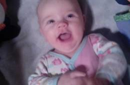 This image shows the most amazing baby ever with her toys.