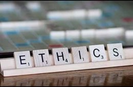 This image shows scrabble tiles spelling out the word ethics.