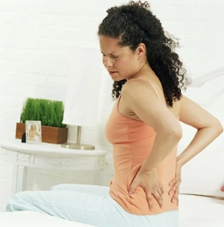 This image shows a woman rubbing her back.