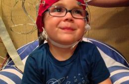 This image shows a child with electrodes on his head.