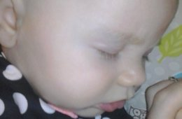This image shows the most beautiful baby sleeping.