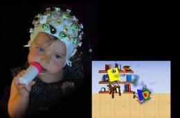 Image shows a little girl wearing a EEG cap.