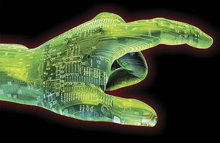 Image shows a hand made up of computer chips.