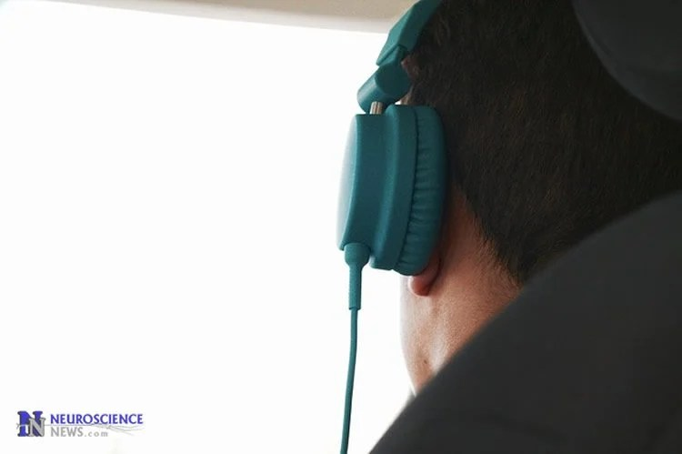 Image of a man with headphones on.