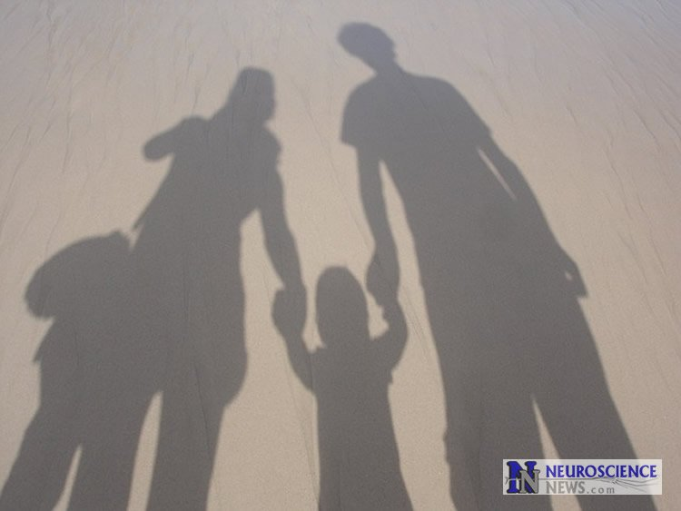 Image shows a family in shadows.