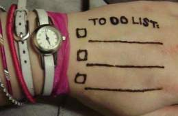 """Photo of a hand with a """"to do"""" list written on it."""