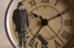 Image shows an old man and a clock.