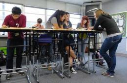 Image shows students studying at standing desks.