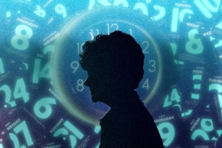 Image shows the outline of a woman's head and a clock.