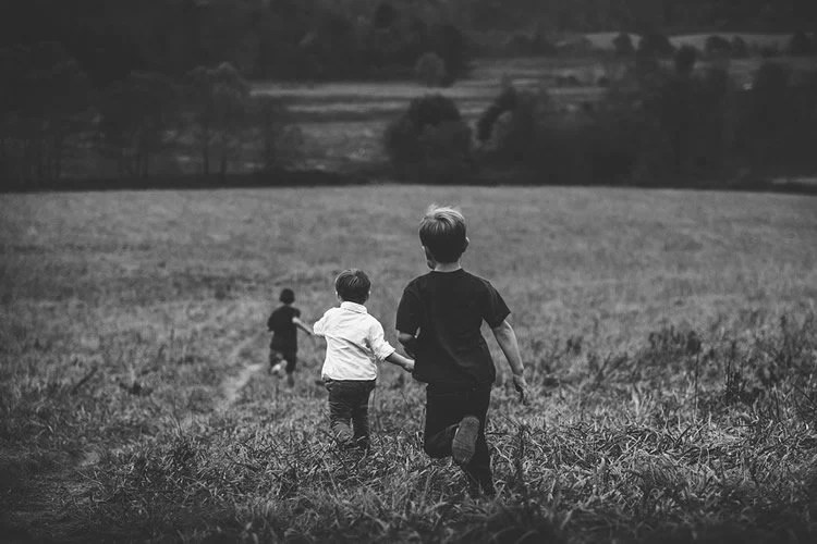 Image shows kids running in a field.
