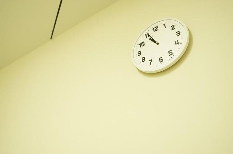 Image shows a clock at 11 pm.