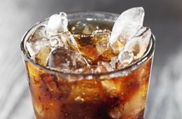 Image shows a glass of soda.