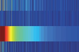 Image shows a rainbow against a blue background.