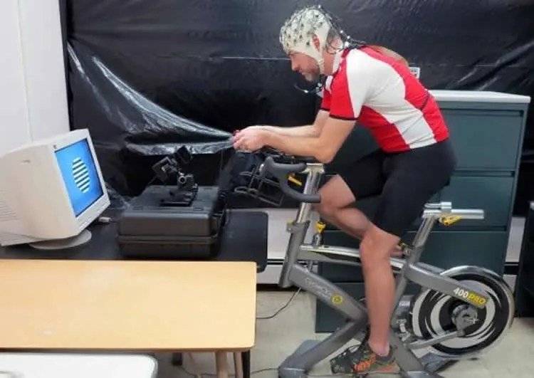 Image shows a man on an exercise bike.