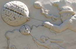 Image shows a brain sand sculpture.