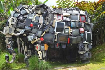 Image shows an elephant statue made of tv's.