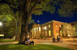 Image shows a college campus at night.