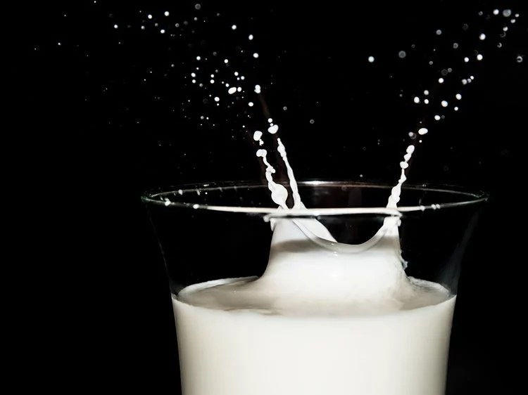 Image shows a glass of milk.