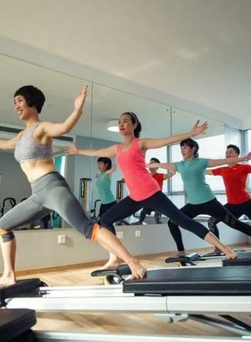 Image shows women doing yoga.