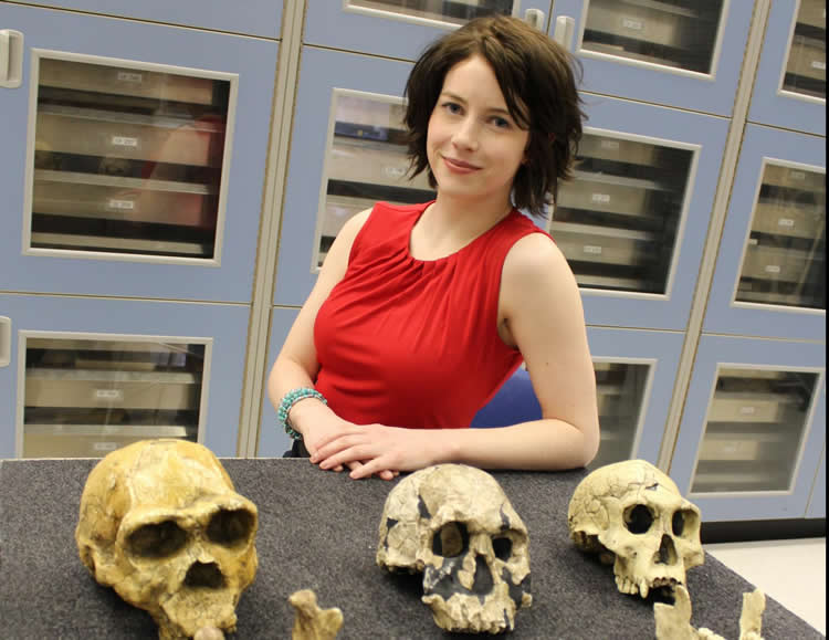 Image shows the researcher with skulls.