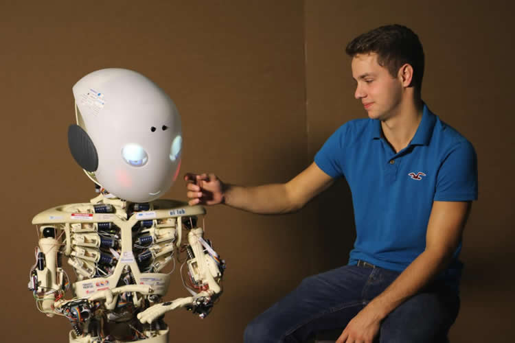 Image shows a man and Roboy the robot.