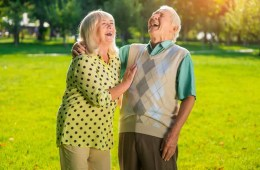 Image shows a couple laughing.