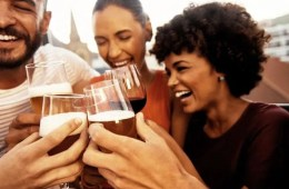 Image shows people drinking wine.