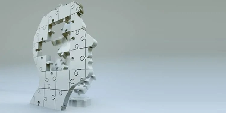 Image shows a jigsaw in the shape of a head.