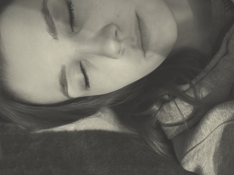 Image shows a woman sleeping.