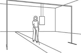 Image shows a blind person with a stick.