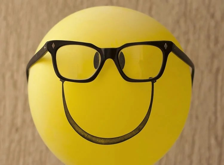Image shows a ballon with glasses and a smiley face