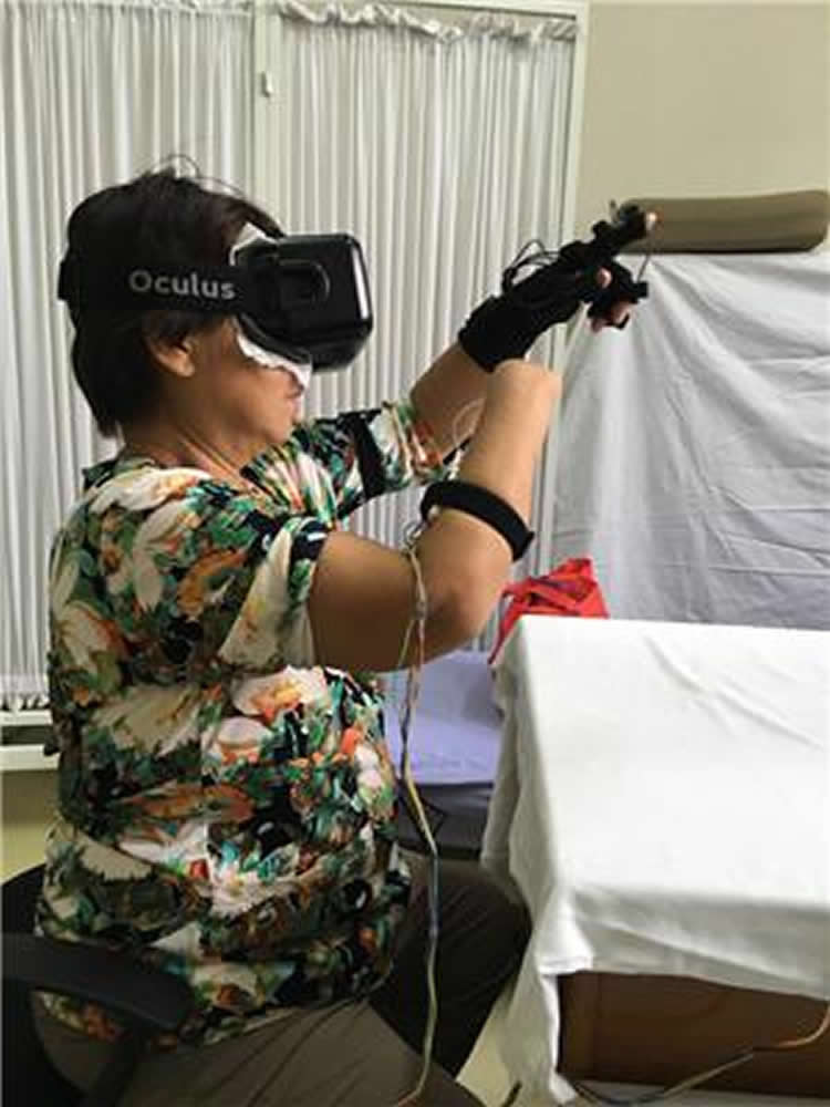 Image shows a lady with one arm participating in the VR study.