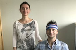 Image shows the researcher and a participant in a headband.