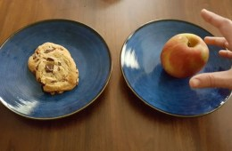 Image shows a cookie and an apple.