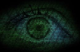 Image shows an eye and binary code.