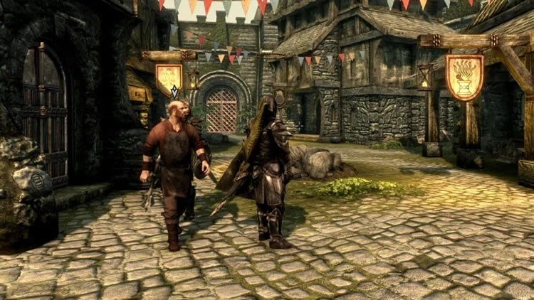 Image shows a Skyrim NPC walking a horse.