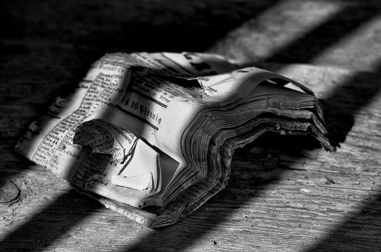 Image shows a scrunched up newspaper.